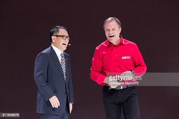 President and CEO of Toyota Motor Corporation Akio Toyoda and the Finnish rally driver Tommi Makinen deliver a speech during the press preview of the...