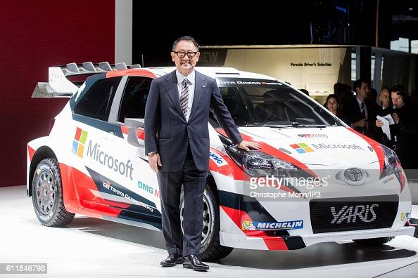 President and CEO of Toyota Motor Corporation Akio Toyoda presents their latest Toyota Yaris car during the press preview of the Paris Motor Show at...
