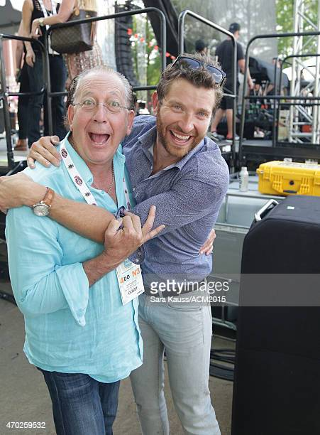 President and CEO of Warner Music Nashville John Esposito and singer Brett Eldredge pose backstage during the ACM Party For A Cause Festival at Globe...