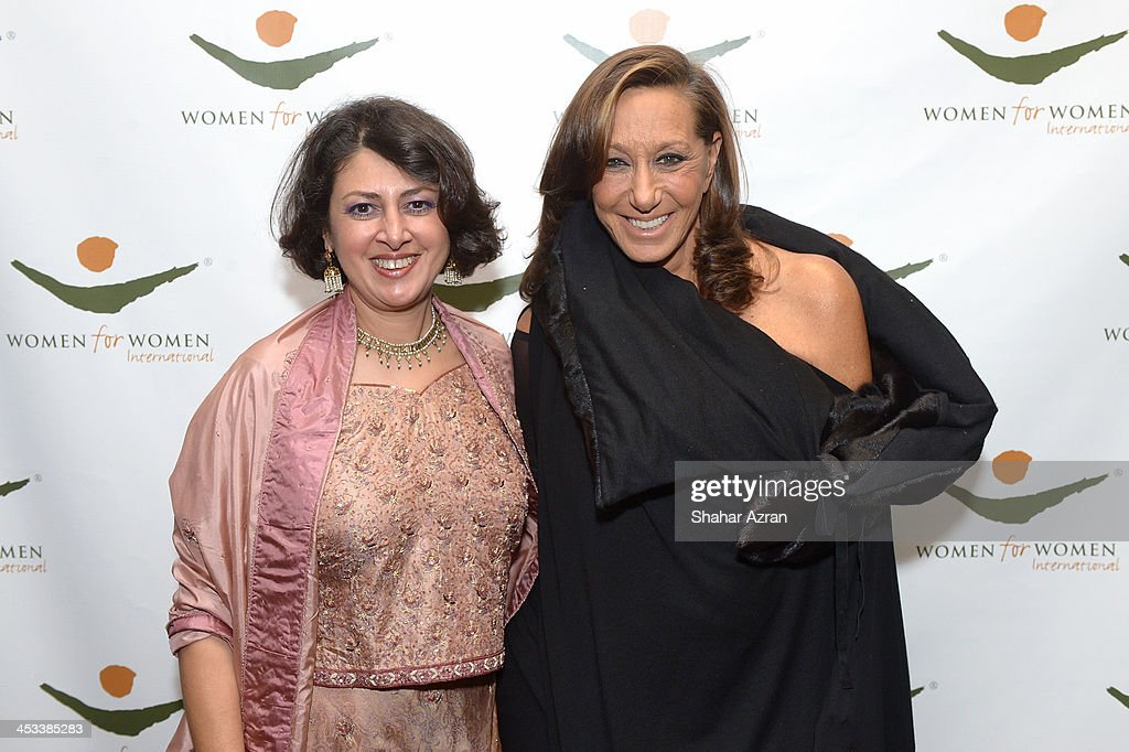 President and CEO of Women for Women International Afshan Khan and Donna Karen attend the Women for Women 20th Anniversary Gala celebration at the American Museum of Natural History on December 3, 2013 in New York City.