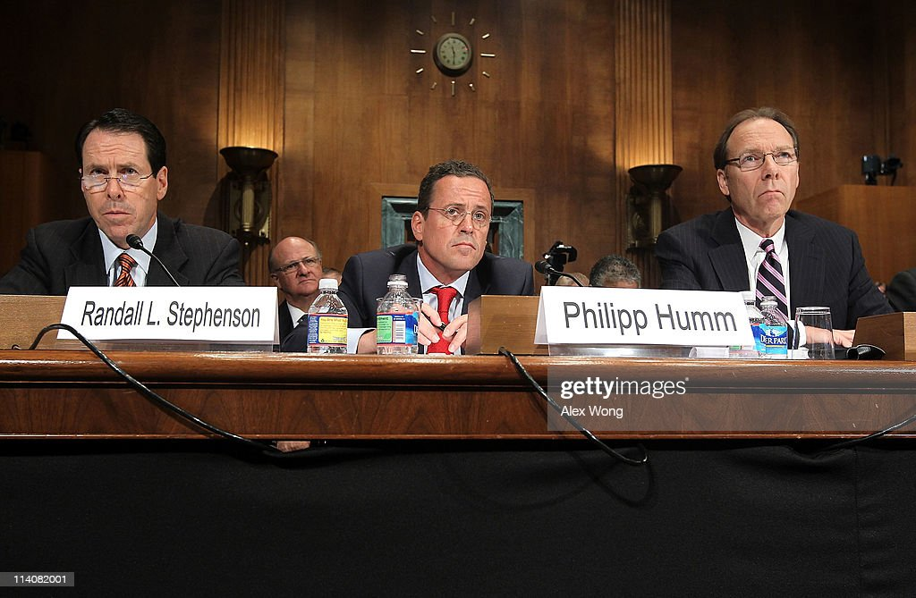 ATT President and CEO Randall Stephenson TMobile USA President and CEO Philipp Humm and Sprint Nextel Corporation CEO Daniel Hesse testify during a...