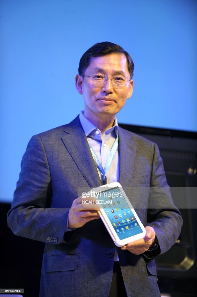 President and CEO Samsung Southwest Asia, BD Park poses with a Galaxy Note 510 during a launch at the Samsung Forum press conference in Hyderabad on March 1, 2013. Samsung Electronics unveiled new products and services at its Southwest Asia Forum 2013. In 2012 Samsung Electronics acheived record sales of approximately 200 billion US dollars in Southwest Asia. AFP PHOTO / Noah SEELAM