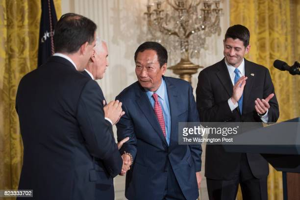 President and chief executive officer of Foxconn greets Vice President Mike Pence and House Speaker Paul Ryan of Wis before President Donald Trump...