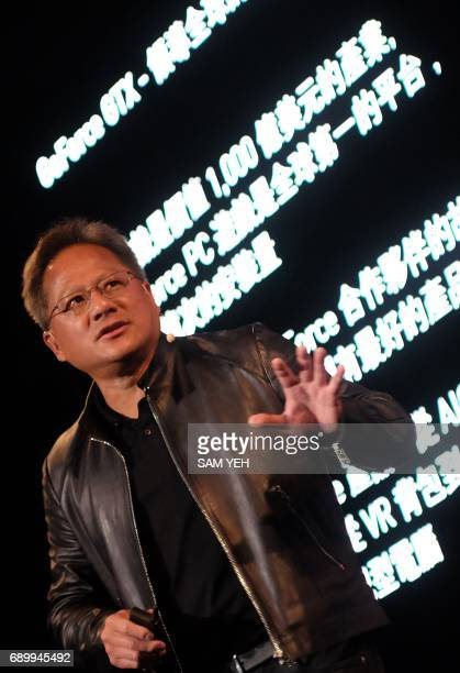 President and Chief Executive Officer of NVIDIA Huang Jenhsun speaks during the Computex Show in Taipei on May 30 2017 More then 5000 booths from...