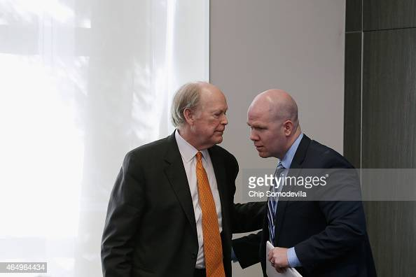 President and Chief Executive Officer of the Federal Reserve Bank of Philadelphia Charles Plosser and Peter ContiBrown talk after participating in a...