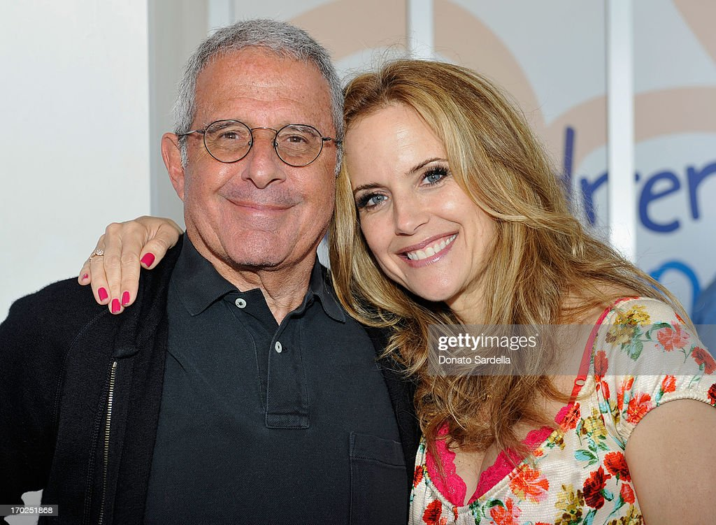 President and Chief Operating Officer of Universal Studios Ron Meyer and actress Kelly Preston attend the 1st Annual Children Mending Hearts Style Sunday on June 9, 2013 in Beverly Hills, California.