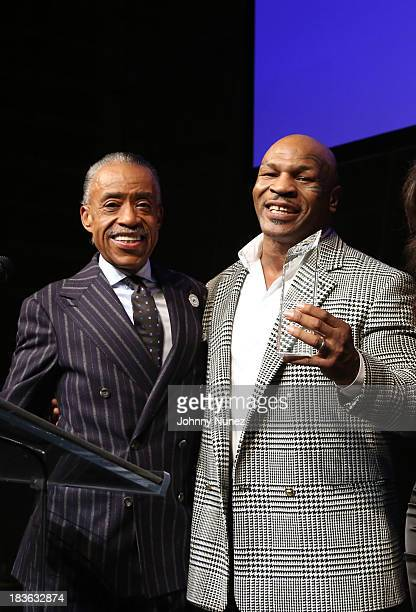 President and Founder of the National Action Network Reverend Al Sharpton and former boxing world champion Mike Tyson attend the 2013 National Action...