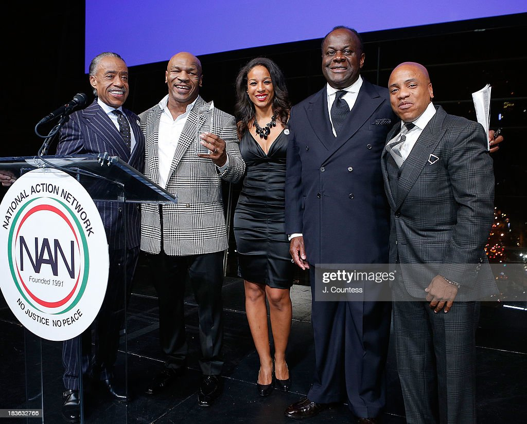 President and founder of the National Action Network Reverend Al Sharpton, Former Boxing champion Mike Tyson, Acting Executive Director of the National Action Network Janaye Ingram, Chairman of the Board at the National Action Network Reverend Dr. W. Franklyn Richardson and Kedar Massenburg pose onstage during The 4th Annual Triumph Awards at Rose Theater, Jazz at Lincoln Center on October 7, 2013 in New York City.