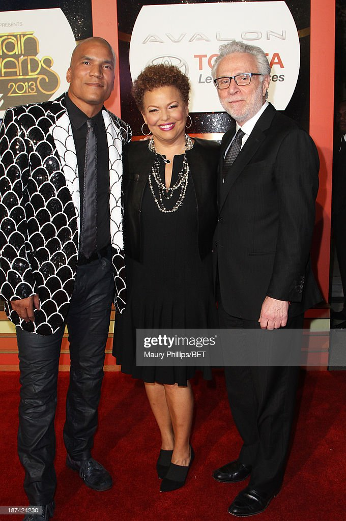 President and General Manager of Centric, Paxton Baker, Chairman and Chief Executive Officer of BET Debra Lee and tv personality <a gi-track='captionPersonalityLinkClicked' href=/galleries/search?phrase=Wolf+Blitzer&family=editorial&specificpeople=221464 ng-click='$event.stopPropagation()'>Wolf Blitzer</a> attend the Soul Train Awards 2013 at the Orleans Arena on November 8, 2013 in Las Vegas, Nevada.