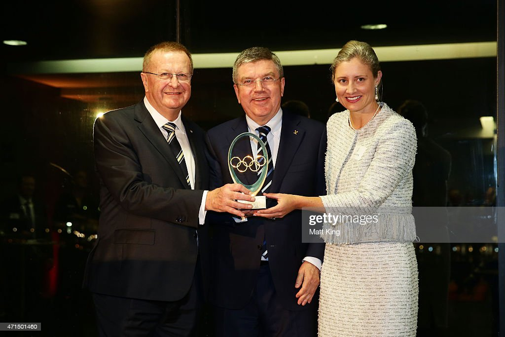 President and IOC Vice President <a gi-track='captionPersonalityLinkClicked' href=/galleries/search?phrase=John+Coates&family=editorial&specificpeople=233445 ng-click='$event.stopPropagation()'>John Coates</a> (L) and AOC Secretary General Fiona de Jong (R) accept an IOC award from IOC President <a gi-track='captionPersonalityLinkClicked' href=/galleries/search?phrase=Thomas+Bach&family=editorial&specificpeople=610149 ng-click='$event.stopPropagation()'>Thomas Bach</a> (C) at an AOC cocktail reception at the Museum of Contemporary Art on April 29, 2015 in Sydney, Australia.