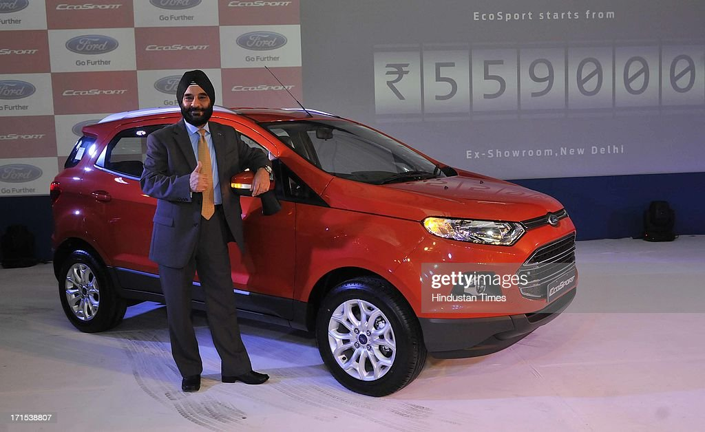 President and Managing Director of Ford India, Joginder Singh poses with newly launched Ford EcoSport on June 26, 2013 in New Delhi, India. The model will be available with three engine options of 1 litre petrol with Ecoboost technology, 1.5 litre petrol and 1.5 litre diesel engine.