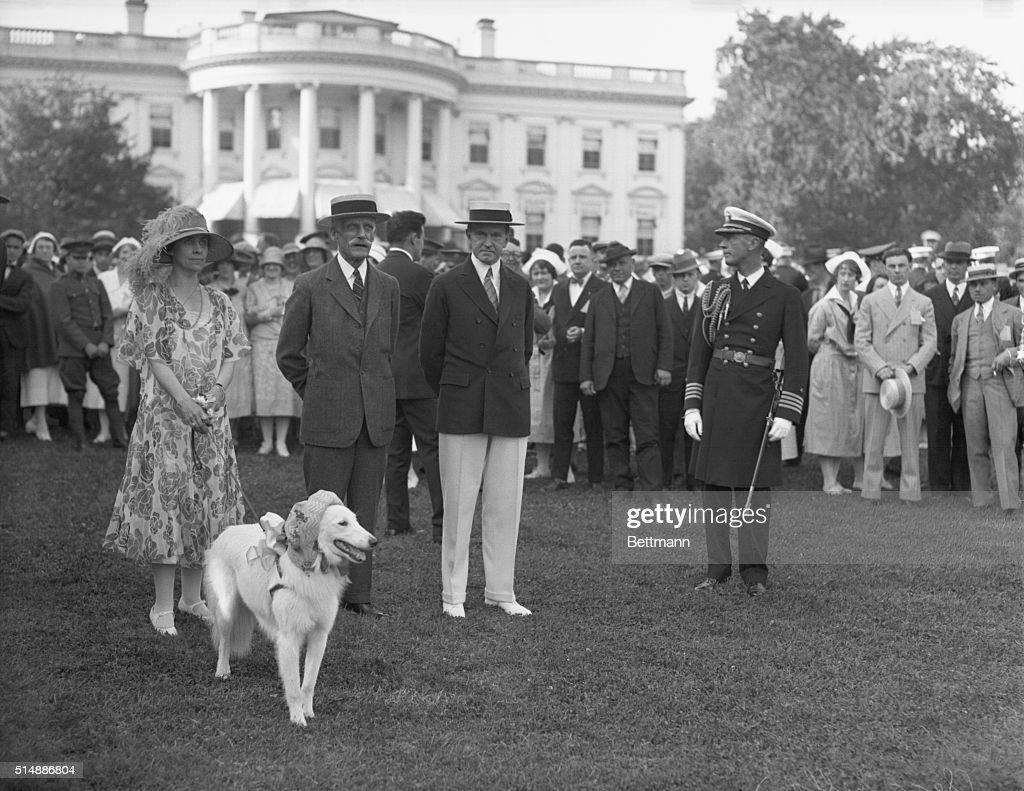 President and Mrs. <a gi-track='captionPersonalityLinkClicked' href=/galleries/search?phrase=Calvin+Coolidge&family=editorial&specificpeople=90488 ng-click='$event.stopPropagation()'>Calvin Coolidge</a> with <a gi-track='captionPersonalityLinkClicked' href=/galleries/search?phrase=Andrew+Mellon&family=editorial&specificpeople=908430 ng-click='$event.stopPropagation()'>Andrew Mellon</a> and others on the White House lawn.