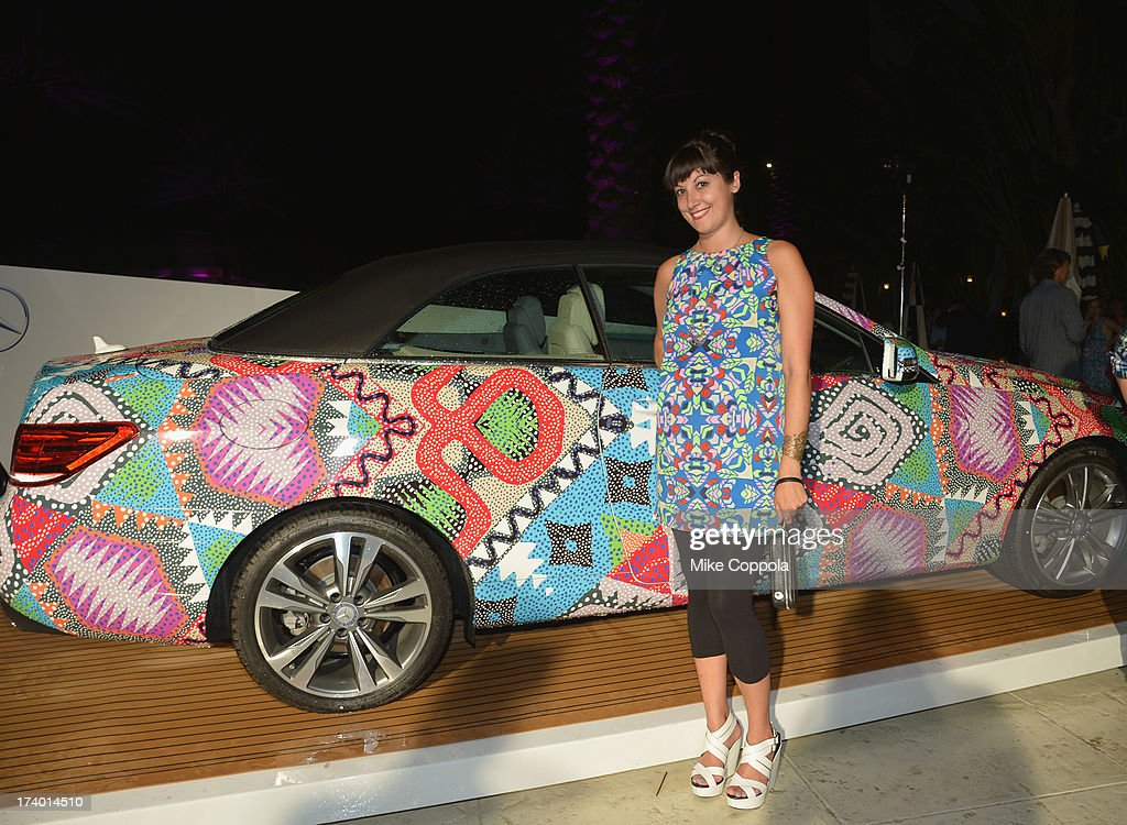 PR President and Partner at People's Revolution Emily Bungert poses in front of the 2014 Mercedes-Benz E350 Cabriolet by Mara Hoffman at Mercedes-Benz Fashion Week Swim 2014 Official Coverage - Day 1 at Raleigh Hotel on July 18, 2013 in Miami Beach, Florida.