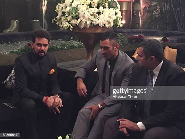 President Anurag Thakur and Indian cricketer MS Dhoni during the wedding reception of Indian Cricketer Yuvraj Singh and Bollywood actor Hazel Keech...