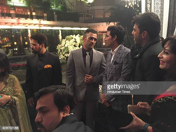 BCCI president Anurag Thakur with cricketers MS Dhoni and Mohammad Kaif during the wedding reception of Indian Cricketer Yuvraj Singh and Bollywood...