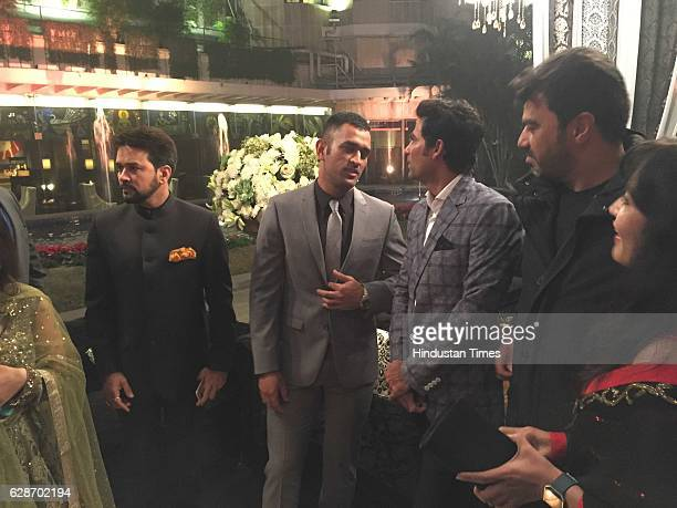President Anurag Thakur with cricketers MS Dhoni and Mohammad Kaif during the wedding reception of Indian Cricketer Yuvraj Singh and Bollywood actor...