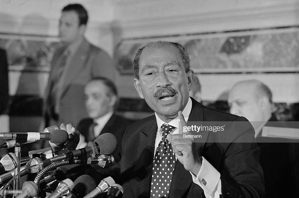 President Anwar Sadat of Egypt, is shown answering newsmen during a press conference given at Hotel Narigny. President Sadat said he 'insisted' in an exchange of messages with President Reagan that the United States continue its' important role in Middle East peace efforts, as before and received a 'very Favorable' reply.