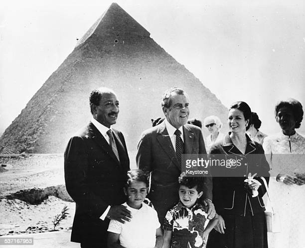 President Anwar Sadat of Egypt with US President Richard Nixon and his family visiting the Great Pyramids at Giza Egypt June 1974
