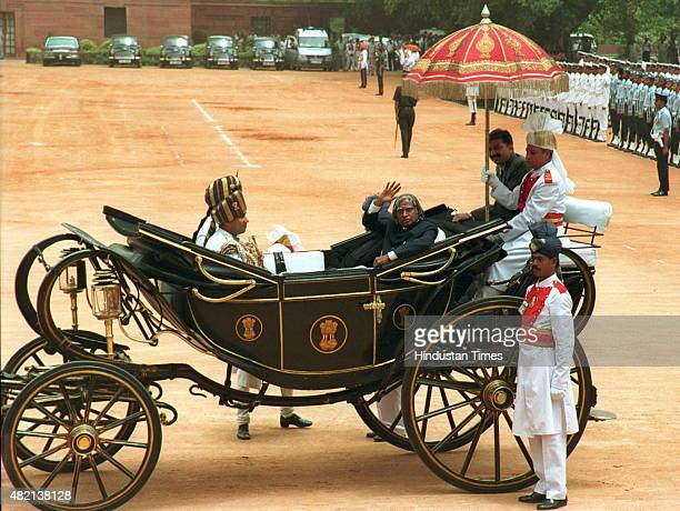 President APJ Abdul Kalam waves while traveling in horse carriage at the ceremonial reception in the forecourt of Rashtrapati Bhavan after the...