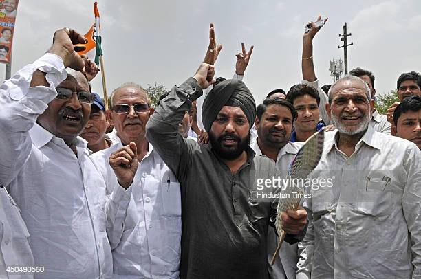 President Arvinder Sing Lovely with EXMP Sajjan Kumar and Ramesh Kumar during the road block protest at Khanpur Chowk MB Road against the ongoing...