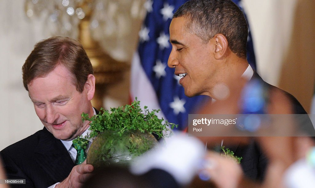 U.S. President Barack Obama (R) accepts a bowl of shamrocks from Irish Prime Minister Enda Kenny, during a reception in the East Room of the White House on March 19, 2013 in Washington, DC. President Obama met with Irish Prime Minister Enda Kenny prior to the annual St. Patrick's Day lunch hosted at the Capitol.