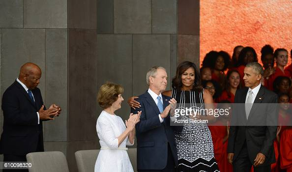 S President Barack Obama accompanied by first lady Michelle Obama former president George W Bush and former first lady Laura Bush participate in the...