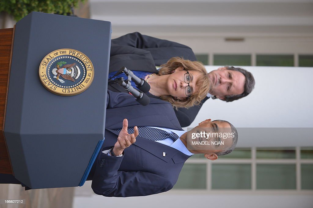 US President Barack Obama, accompanied by former lawmaker Gabrielle Giffords (C), speaks on gun control and the vote at the US Senate on April 17, 2013 in the Rose Garden of the White House in Washington, DC. The US Senate rejected bipartisan legislation that would have expanded background checks for firearm sales, leaving a gaping hole in President Barack Obama's drive to improve gun safety after December's school massacre. With 60 votes needed for approval, the measure requiring background checks on sales at gun shows and on the Internet fell well short, in a 54-46 vote, as a handful of Democrats either facing tough re-election challenges in 2014 or from pro-gun states stood in opposition of the amendment. AFP PHOTO/Mandel NGAN