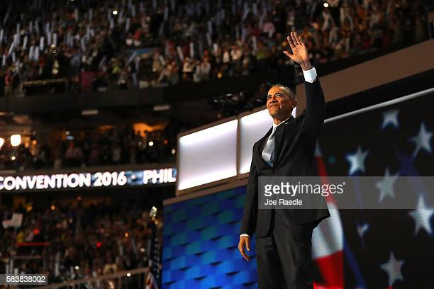 President Barack Obama acknowledges the crowd as he arrives on stage to deliver remarks on the third day of the Democratic National Convention at the...