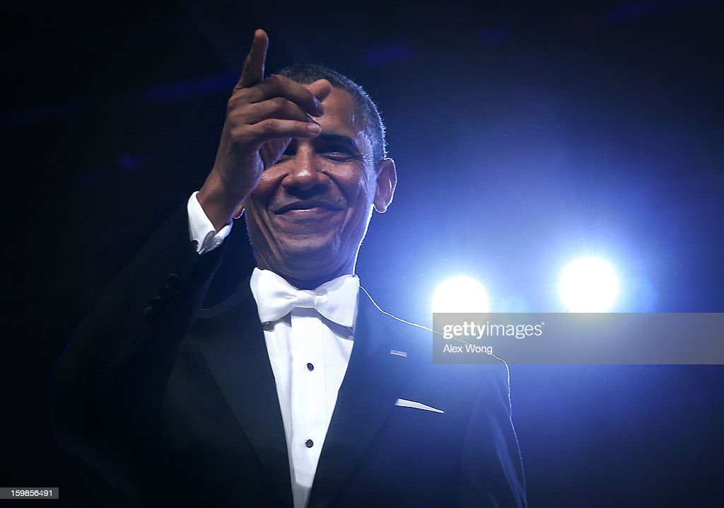 U.S. President Barack Obama acknowledges the crowd during the Inaugural Ball January 21, 2013 at Walter E. Washington Convention Center in Washington, DC. The president was sworn-in for a second term earlier in the day.