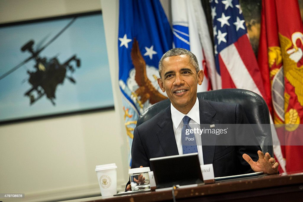 US President Barack Obama acknowledges the media at the start of a meeting with members of the president's national security team concerning ISIS...