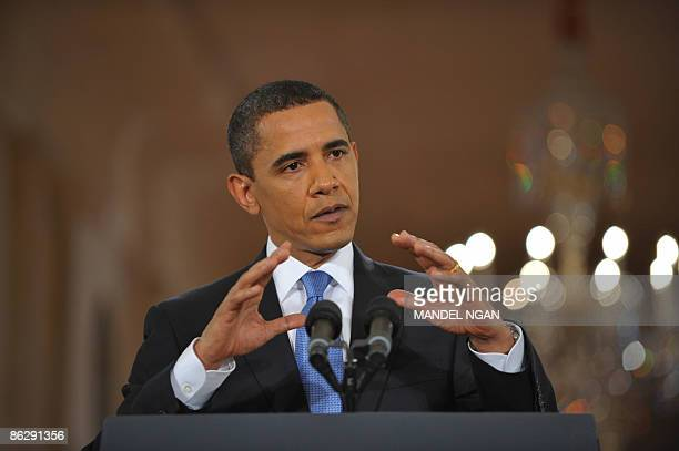 US President Barack Obama addresses a prime time press conference on his 100th day in office in the East Room of the White House April 29 2009 in...
