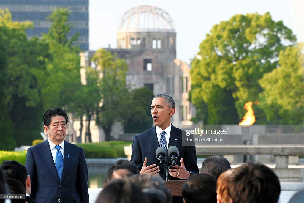 U.S. President <a gi-track='captionPersonalityLinkClicked' href=/galleries/search?phrase=Barack+Obama&family=editorial&specificpeople=203260 ng-click='$event.stopPropagation()'>Barack Obama</a> addresses while Japanese Prime Minister <a gi-track='captionPersonalityLinkClicked' href=/galleries/search?phrase=Shinzo+Abe&family=editorial&specificpeople=559017 ng-click='$event.stopPropagation()'>Shinzo Abe</a> listens after offering wreaths at the cenotaph at the Hiroshima Peace Memorial Park on May 27, 2016 in Hiroshima, Japan. Obama becomes the first sitting U.S. president to visit Hiroshima, where the first atomic bomb was dropped in 1945 at the end of World War II.