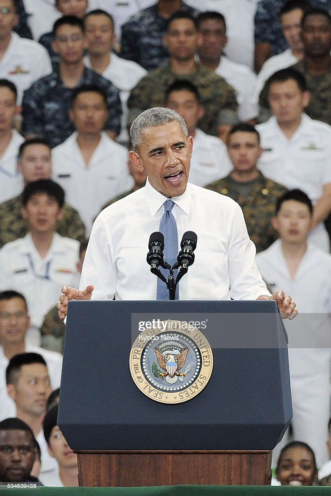 U.S. President Barack Obama addresses U.S. servicemen at the Marine Corps' Air Station Iwakuni in western Japan on May 27, 2016, before visiting the atomic bombed city of Hiroshima.