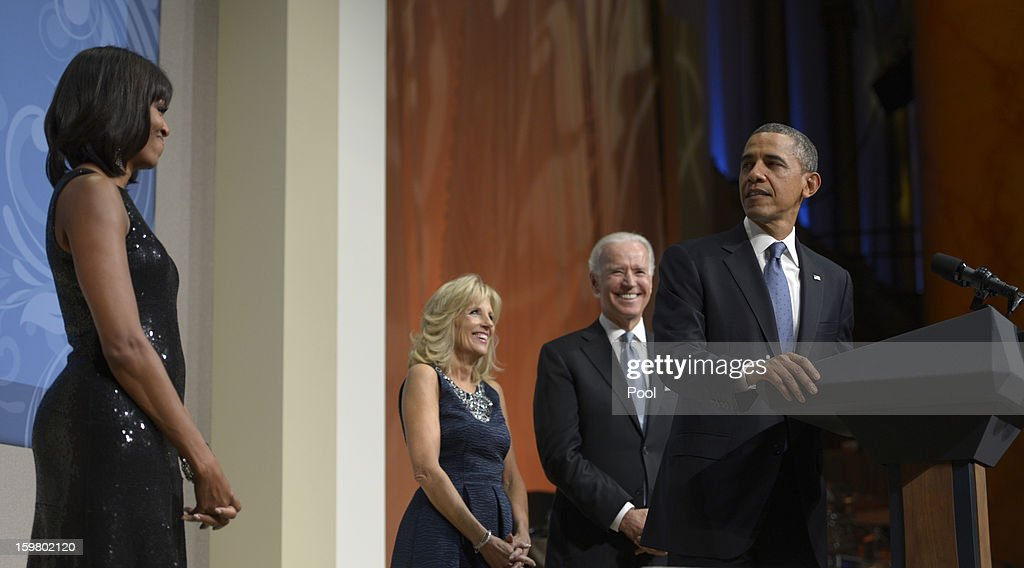 U.S. President <a gi-track='captionPersonalityLinkClicked' href=/galleries/search?phrase=Barack+Obama&family=editorial&specificpeople=203260 ng-click='$event.stopPropagation()'>Barack Obama</a>, along with first lady <a gi-track='captionPersonalityLinkClicked' href=/galleries/search?phrase=Michelle+Obama&family=editorial&specificpeople=2528864 ng-click='$event.stopPropagation()'>Michelle Obama</a>, Vice President <a gi-track='captionPersonalityLinkClicked' href=/galleries/search?phrase=Joseph+Biden&family=editorial&specificpeople=206897 ng-click='$event.stopPropagation()'>Joseph Biden</a> and <a gi-track='captionPersonalityLinkClicked' href=/galleries/search?phrase=Jill+Biden&family=editorial&specificpeople=997040 ng-click='$event.stopPropagation()'>Jill Biden</a>, delivers remarks at the Inaugural Reception at the National Building Museum on January 20, 2013 in Washington, D.C. Obama defeated Republican candidate Mitt Romney on Election Day 06 November 2012 to be re-elected for a second term.