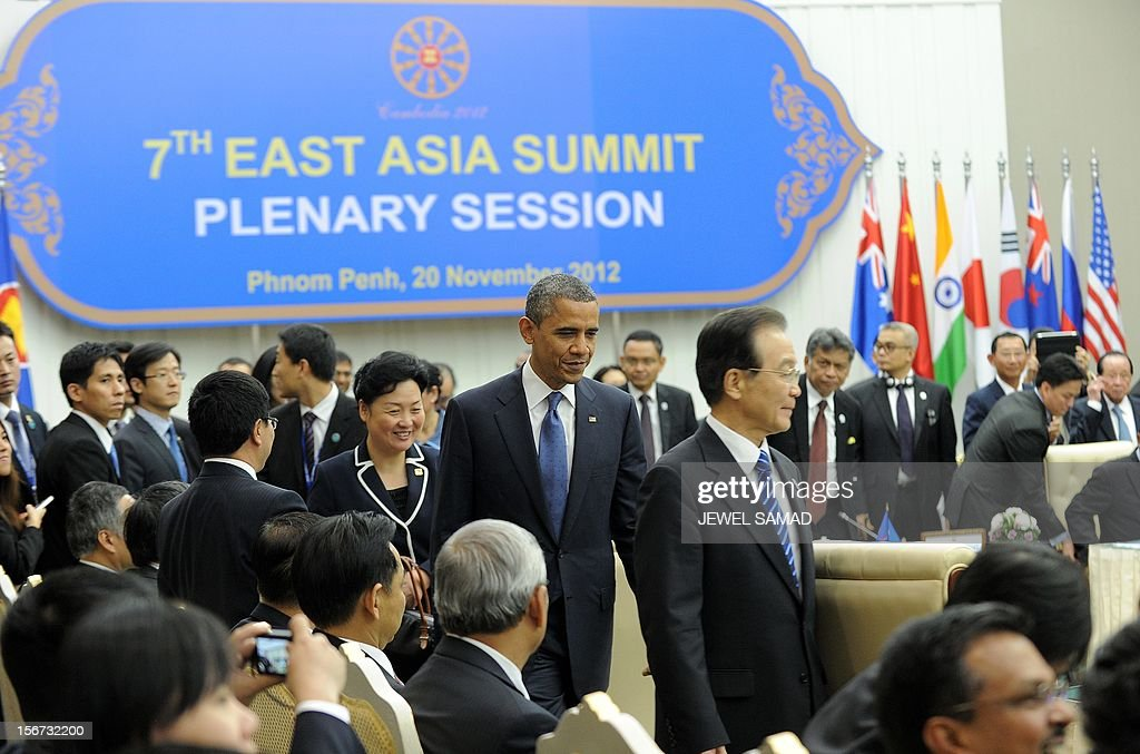 US President Barack Obama along with other leaders arrive to attend the East Asian Summit Plenary Session at the Peace Palace in Phnom Penh on November 20, 2012. During the two-day East Asia Summit, Obama was scheduled to hold talks with the leaders of the 10-member Association of Southeast Asian Nations (ASEAN) along with Chinese Premier Wen Jiabao(C-R) and Japan's Premier Yoshihiko Noda. AFP PHOTO Jewel Samad