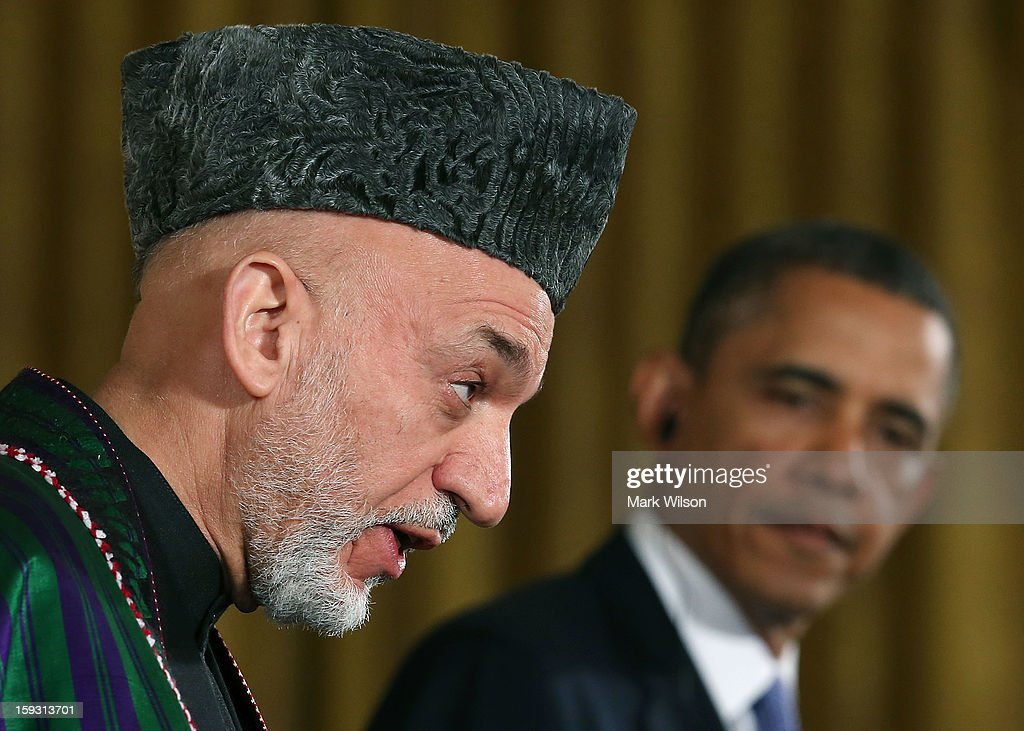 U.S. President <a gi-track='captionPersonalityLinkClicked' href=/galleries/search?phrase=Barack+Obama&family=editorial&specificpeople=203260 ng-click='$event.stopPropagation()'>Barack Obama</a> (R) and Afghan President <a gi-track='captionPersonalityLinkClicked' href=/galleries/search?phrase=Hamid+Karzai&family=editorial&specificpeople=121540 ng-click='$event.stopPropagation()'>Hamid Karzai</a> speak to the media during a joint news conference in the East Room of the White House January 11, 2013 in Washington, DC. Karzai is in Washington for face-to-face meetings with Obama and senior members of his administration about the future of American commitment to Afghanistan and when troops may leave the country after more than 10 years of war.