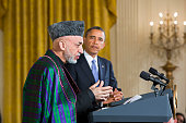 US President Barack Obama and Afghanistan President Hamid Karzai hold a joint news conference in the East Room of the White House in Washington