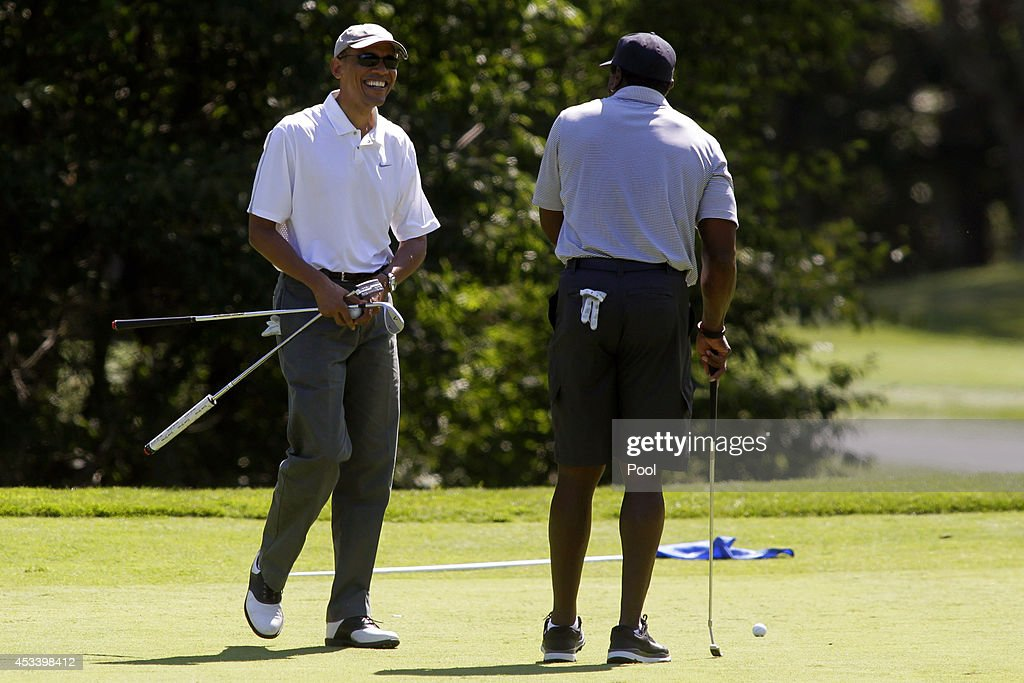 President Barack Obama and Ahmad Rashad made a putt on the first green at the Farm Neck Golf Club on August 9, 2014 in Oak Bluffs, Massachusetts. The Obama's are vacationing on the island for two weeks.