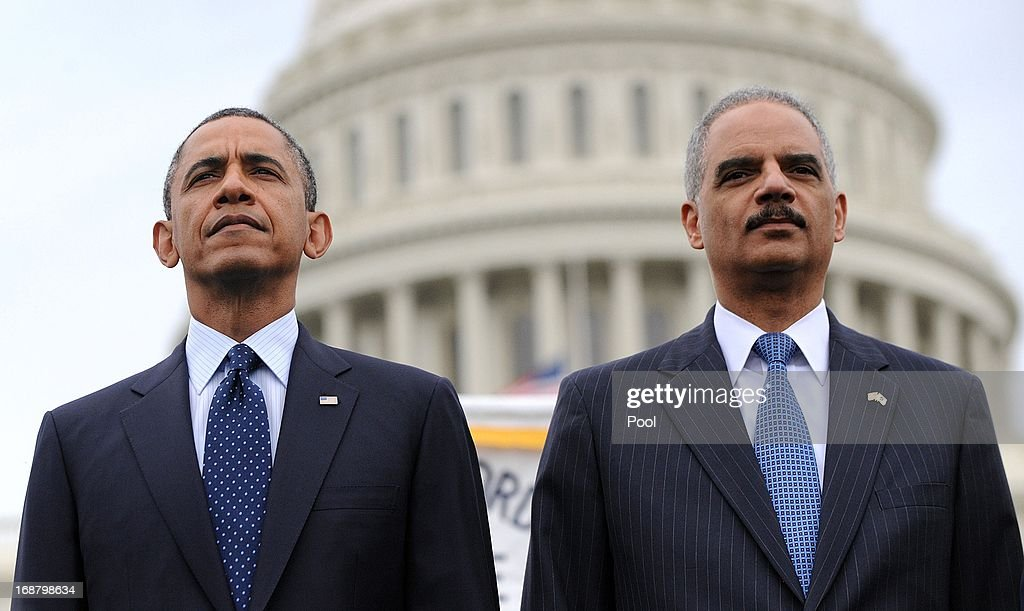U.S. President <a gi-track='captionPersonalityLinkClicked' href=/galleries/search?phrase=Barack+Obama&family=editorial&specificpeople=203260 ng-click='$event.stopPropagation()'>Barack Obama</a> (L) and Attorney General <a gi-track='captionPersonalityLinkClicked' href=/galleries/search?phrase=Eric+Holder&family=editorial&specificpeople=1060367 ng-click='$event.stopPropagation()'>Eric Holder</a> attend the 32nd annual National Peace Officers' Memorial Service at the West Front Lawn at the U.S. Capitol May 15, 2013 in Washington, DC. President <a gi-track='captionPersonalityLinkClicked' href=/galleries/search?phrase=Barack+Obama&family=editorial&specificpeople=203260 ng-click='$event.stopPropagation()'>Barack Obama</a> delivered remarks at the event, invoking the law enforcement officers who worked to bring the Boston Marathon bombing suspects to justice.