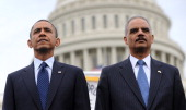 US President Barack Obama and Attorney General Eric Holder attend the 32nd annual National Peace Officers' Memorial Service at the West Front Lawn at...