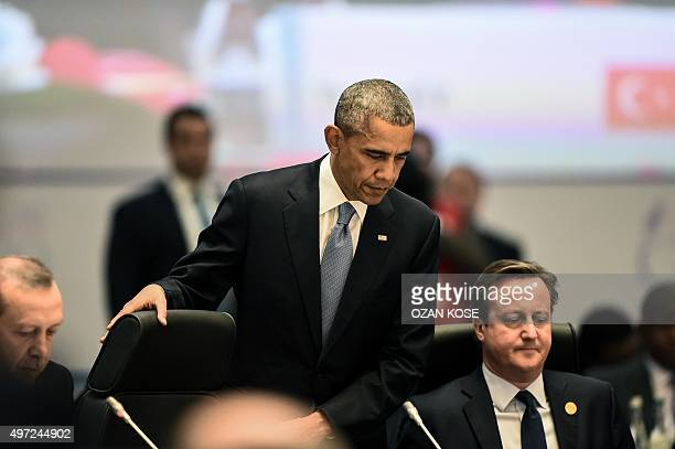 US President Barack Obama and British Prime Minister David Cameron attend a working session on the Global Economy during the G20 summit in Antalya on...