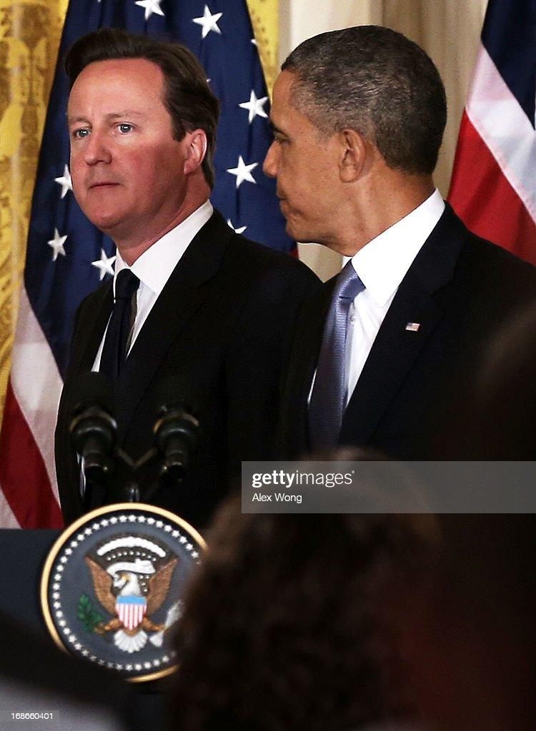 U.S. President Barack Obama (R) and British Prime Minister David Cameron (L) arrive at a joint news conference in the East Room at the White House May 13, 2013 in Washington, DC. The two leaders discussed the prospect of an European Union-United States trade deal and the ongoing civil war in Syria. During his three-day visit to the United States, Cameron will also be briefed by the FBI about the Boston Marathon Bombings and will travel to New York to take part in United Nations talks on new development goals.