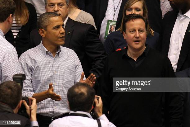 S President Barack Obama and British Prime Minister David Cameron find their seats at UD Arena to watch the Western Kentucky Hilltoppers take on the...