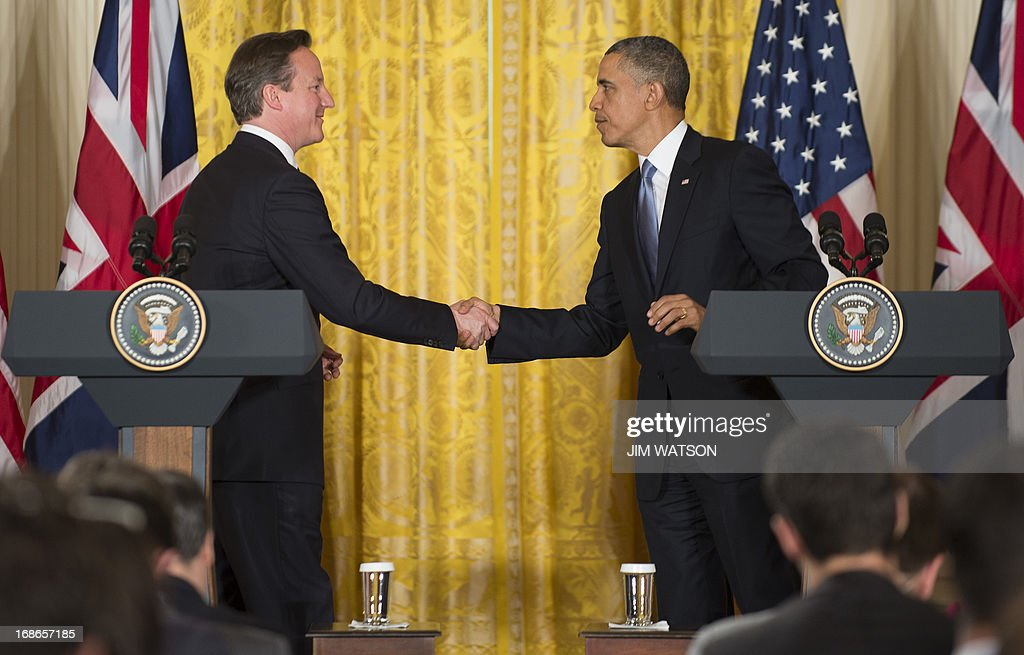 US President Barack Obama(R) and British Prime Minister David Cameron shake hands during a press conference at the White House in Washington, DC, May 13, 2013.