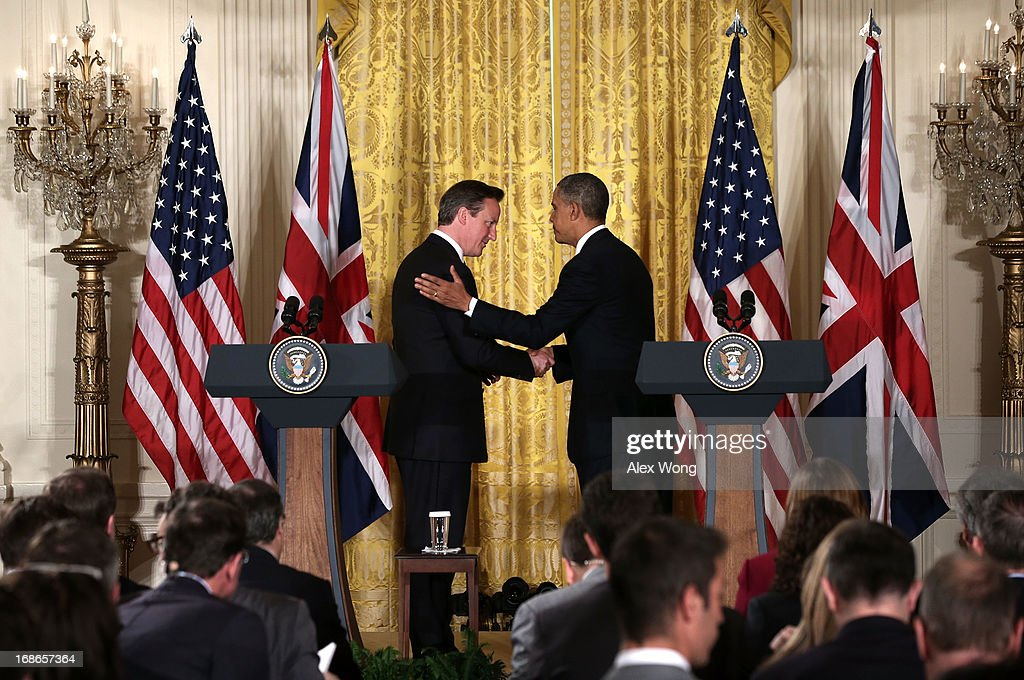 U.S. President <a gi-track='captionPersonalityLinkClicked' href=/galleries/search?phrase=Barack+Obama&family=editorial&specificpeople=203260 ng-click='$event.stopPropagation()'>Barack Obama</a> (R) and British Prime Minister <a gi-track='captionPersonalityLinkClicked' href=/galleries/search?phrase=David+Cameron+-+Politician&family=editorial&specificpeople=227076 ng-click='$event.stopPropagation()'>David Cameron</a> (L) shake hands during a joint news conference in the East Room at the White House May 13, 2013 in Washington, DC. The two leaders discussed the prospect of an European Union-United States trade deal and the ongoing civil war in Syria. During his three-day visit to the United States, Cameron will also be briefed by the FBI about the Boston Marathon Bombings and will travel to New York to take part in United Nations talks on new development goals.