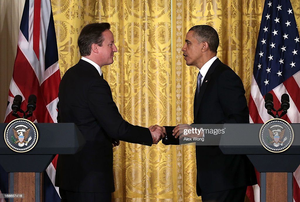 U.S. President Barack Obama (R) and British Prime Minister David Cameron (L) shake hands during a joint news conference in the East Room at the White House May 13, 2013 in Washington, DC. The two leaders discussed the prospect of an European Union-United States trade deal and the ongoing civil war in Syria. During his three-day visit to the United States, Cameron will also be briefed by the FBI about the Boston Marathon Bombings and will travel to New York to take part in United Nations talks on new development goals.