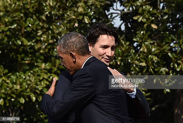 US President Barack Obama and Canada's Prime Minister Justin Trudeau hug during a welcome ceremony during a State Visit at the White House on March...