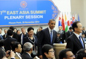 US President Barack Obama and Chinese Premier Wen Jiabao arrives with other leaders to attend an East Asian Summit Plenary Session at the Peace...
