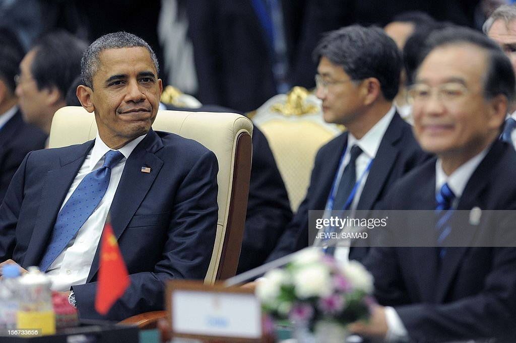 US President Barack Obama (L) and Chinese Premier Wen Jiabao (front R) attend the East Asian Summit Plenary Session at the Peace Palace in Phnom Penh on November 20, 2012. During the two-day East Asia Summit in Phnom Penh, Obama was scheduled to hold talks with the leaders of the 10-member Association of Southeast Asian Nations (ASEAN) along with Chinese Premier Wen Jiabao and Japan's Yoshihiko Noda. AFP PHOTO / Jewel Samad