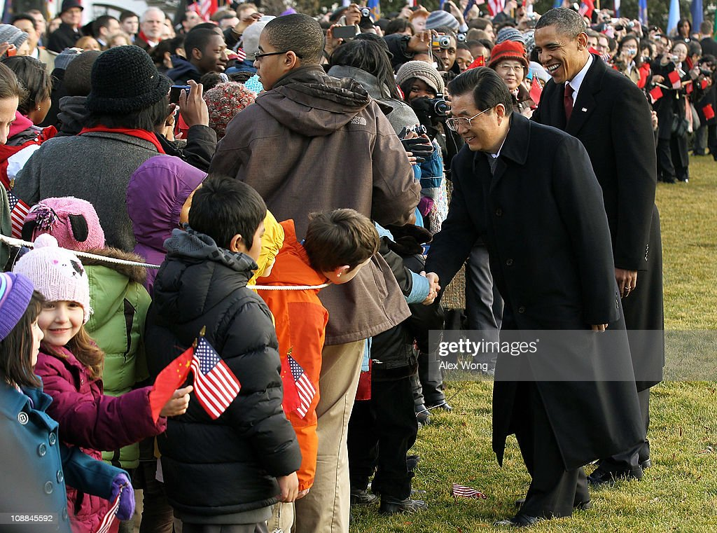 U.S. President <a gi-track='captionPersonalityLinkClicked' href=/galleries/search?phrase=Barack+Obama&family=editorial&specificpeople=203260 ng-click='$event.stopPropagation()'>Barack Obama</a> (R) and Chinese President <a gi-track='captionPersonalityLinkClicked' href=/galleries/search?phrase=Hu+Jintao&family=editorial&specificpeople=203109 ng-click='$event.stopPropagation()'>Hu Jintao</a> (2nd R) inspect the honor guards as they participate during a state arrival ceremony at the South Lawn of the White House January 19, 2011 in Washington, DC. Hu and President Obama will hold a press conference at the White House later today.